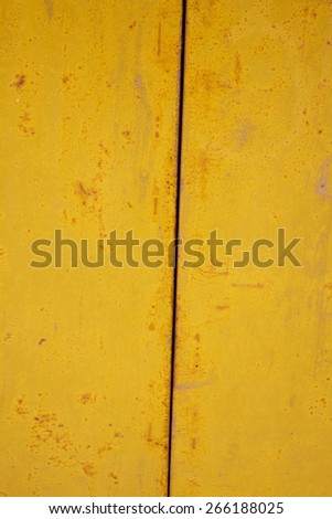 Abstract textured background grunge rusty metal surface painted with bright yellow paint. Great background or texture. - stock photo