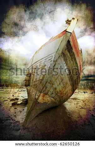 abstract textured image of a beached fishing trawler to give a well worn vintage look - stock photo