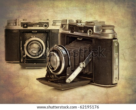 abstract textured image of vintage cameras to give an antique look - stock photo