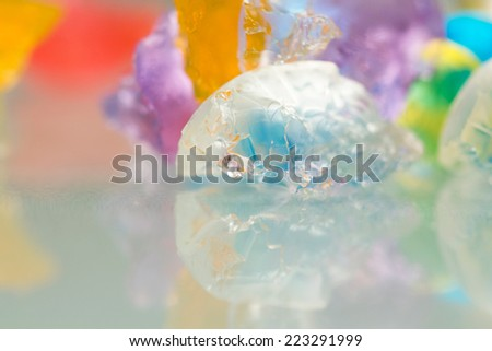 Abstract textures and patterns of broken jelly balls with reflexions  - stock photo