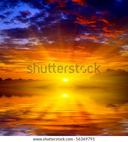 Abstract theme with hot sunset over water - stock photo