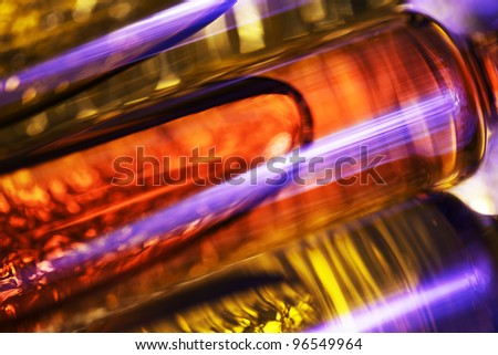 Abstract theme with three ampules. Very shallow depth of field. - stock photo