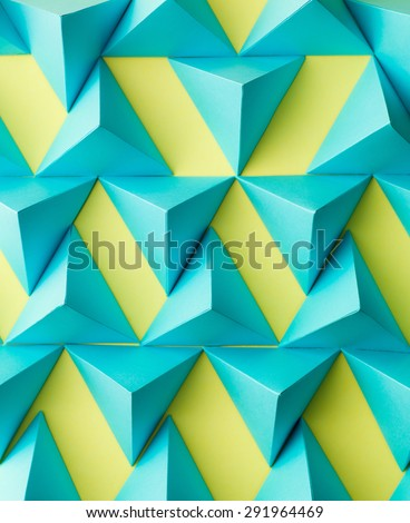 abstract three dimensional mosaic made out of pyramids - stock photo