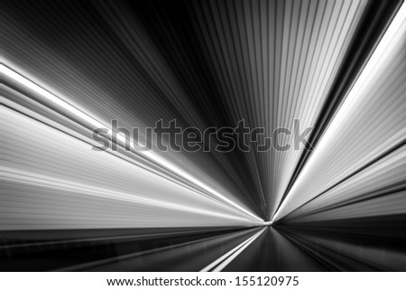Abstract  time-warp  photo taken from a moving car inside a tunnel. - stock photo