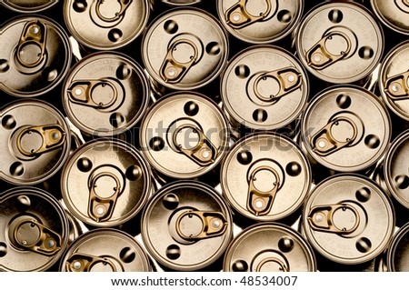 abstract top view of a number of tin cans