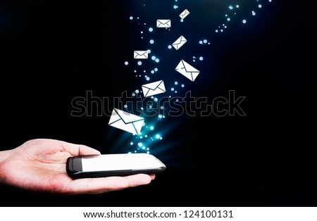 Abstract, touching mobile phone, flying envelopes. Message streaming composition - stock photo