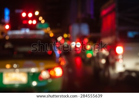 abstract traffic jams night background with blurry shallow depth of focus. - stock photo