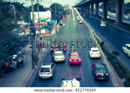 abstract traffic jams with cross process filter background with blurry shallow depth of focus.
