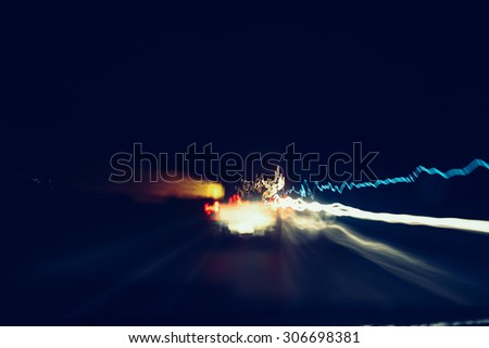 Abstract traffic lights in motion blur at night,vintage toned. - stock photo
