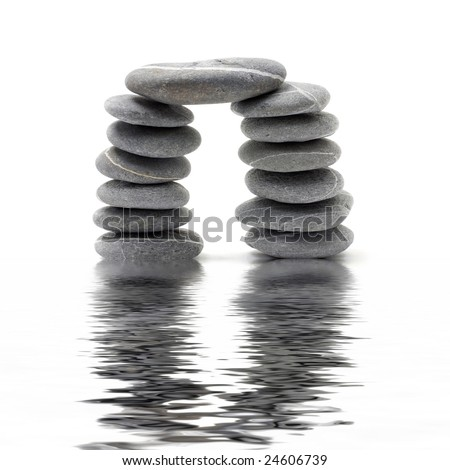 Abstract triumphal arch from a natural stones with reflection - stock photo