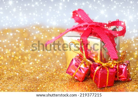 abstract  twinkled  christmas background with stars and gifts - stock photo