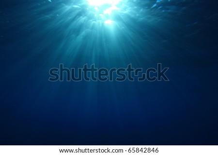 Abstract Underwater Background of Sunburst on Ocean Surface - stock photo