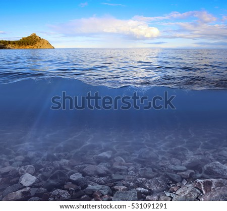 Abstract underwater background with sunbeams on the lake Baikal