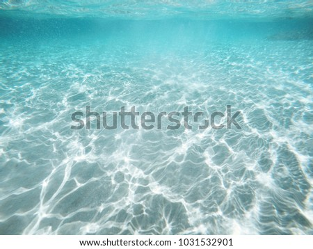 Abstract Underwater view, sunlight ripple over sand , clear sea water background