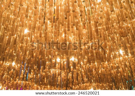Abstract unfocused festive background - bright orange lights as stars - stock photo