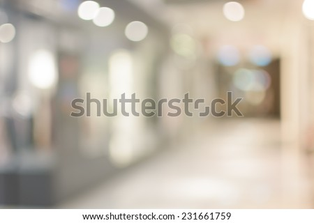 Abstract urban background with blurred buildings and street, shallow depth of focus. - stock photo