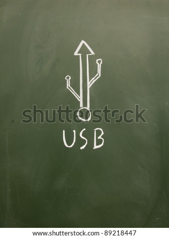 abstract usb sign drawn with chalk on blackboard - stock photo