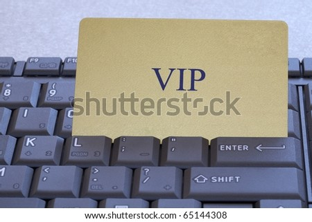 Abstract  V.I.P. card on a multifunctional computer keyboard - stock photo