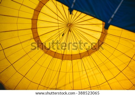 abstract view inside a yellow hot air balloon  - stock photo