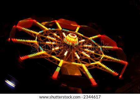 Abstract view of a colourful Ferris Wheel at night - stock photo