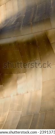 Abstract view of a metal building with various metallic colors.