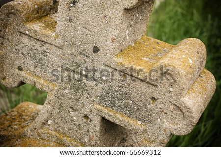 Abstract view of an abandoned rusty-old cross in a cemetery. - stock photo