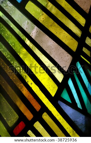 Abstract view of colors and shapes of a stained glass. - stock photo