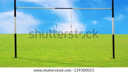 abstract view of empty rugby field and goalposts - stock photo
