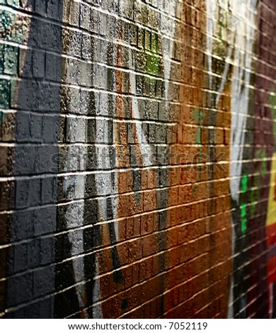 Abstract view of graffiti on bricks - stock photo