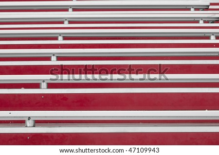 Abstract view of red painted bleachers with white silver metal - stock photo