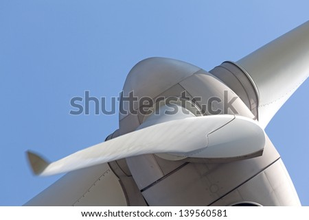 Abstract view of wind turbine with a clear blue sky