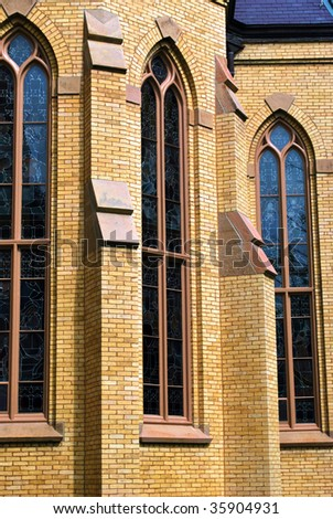 abstract view of windows on a church with yellow brick walls