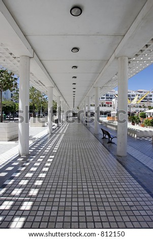 Abstract view through walkway in Puerto Banus in Spain with converging lines