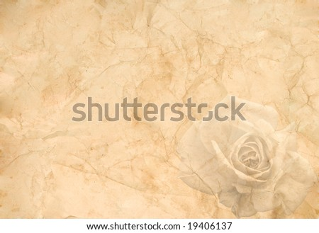 Abstract vintage background (old crumpled paper with a rose in the corner) - stock photo