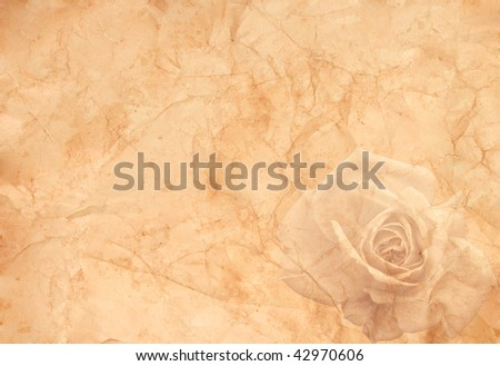 Abstract vintage background (old crumpled paper with a rose in the right corner) - stock photo
