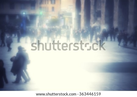Abstract vintage blurred people walking in shopping centre. Effects and blue tones. - stock photo