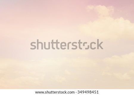 abstract vintage soft clouds and pastel color sky backdrop:colored blurry focus:blur color sunset/morning background with shine lens flare light:blurry pink and purple concept.sweet wallpaper. - stock photo