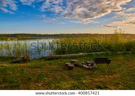 Abstract warm Sunset Lake Camping Fireplace Picnic