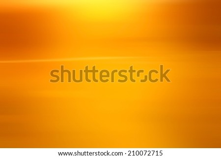 abstract warm yellow background motion blur - stock photo