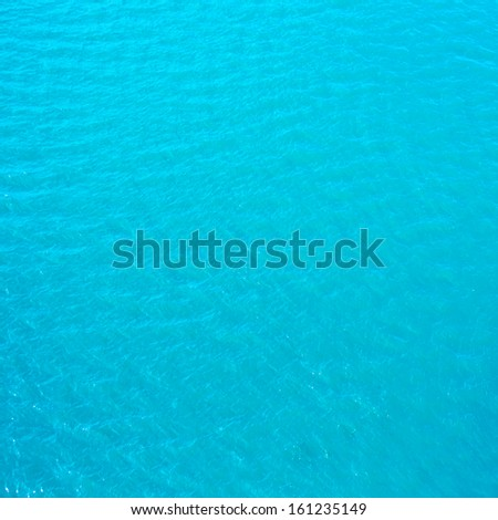 Abstract  water background - bright deep  blue  sea water may use as background or texture. - stock photo