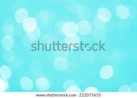 Abstract Water reflect light bokeh background. Light blue filter. - stock photo