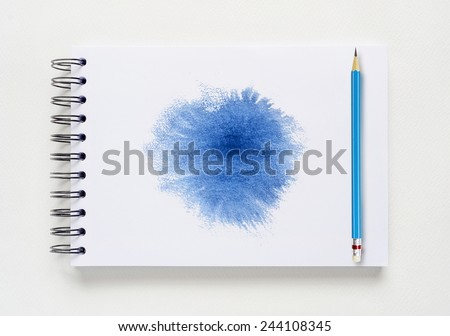 Abstract watercolor brushed and blue pencil on white notebook background. - stock photo