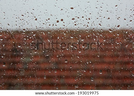 abstract weather background, water drops on the window on an autumn rainy day - stock photo