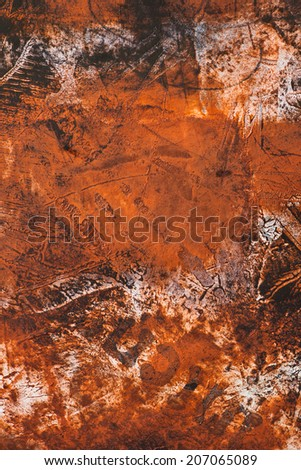 abstract weathered distressed grunge basrelief wall structures, background, backdrop, beautiful detail, vivid rusty orange colors - stock photo