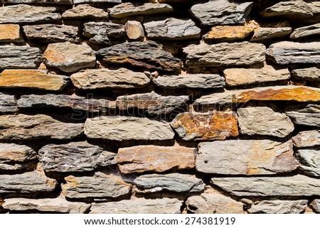 Abstract weathered stone brick background - stock photo