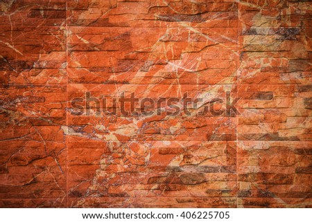 Abstract weathered texture of stained old dark stucco brown and painted red brick wall background in rural room, grungy rusty blocks of stonework technology, colorful horizontal architecture wallpaper