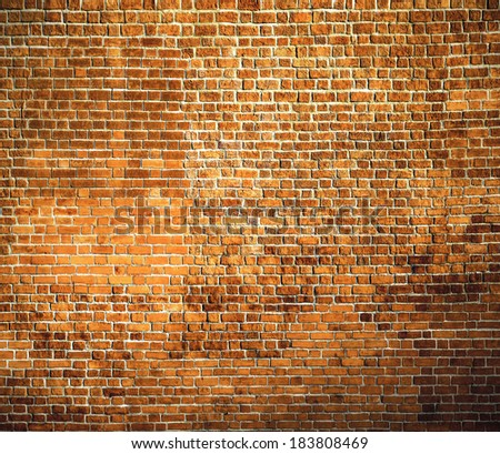 Abstract weathered texture of stained old dark stucco brown and painted red, yellow brick wall background in rural room Grungy rusty blocks of stonework tech darken retro color architecture wallpaper - stock photo