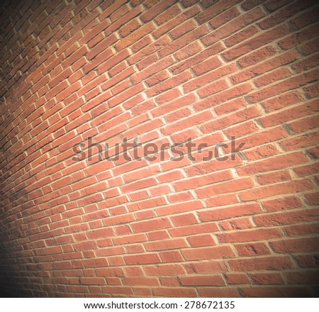 Abstract weathered texture of stained old dark stucco brown and painted red, yellow brick wall background in rural room Grungy rusty blocks of stonework darken ochre retro color architecture wallpaper - stock photo