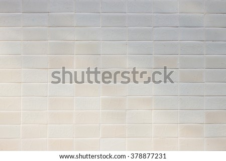 Abstract weathered texture stained old stucco light gray and aged paint white brick wall background in rural room, grungy rusty blocks. - stock photo