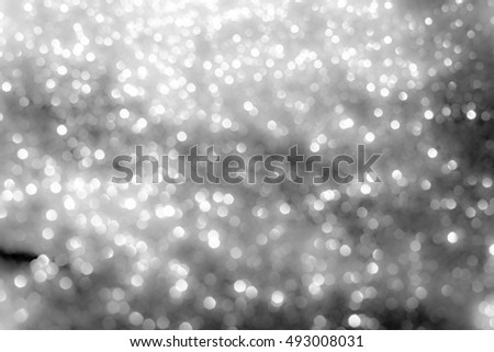 abstract white bokeh lights on grey background